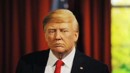 A wax figure of Donald Trump in the Oval office, is unveiled at Madame Tussauds in London, ahead of
