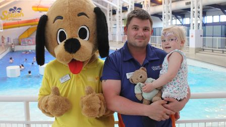 Splash mascot Pooch with operations manager Ash Allen and his two-year-old daughter Belle. Photo: KA