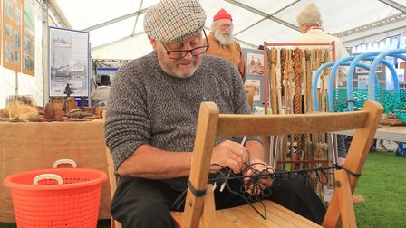Retired fisherman William Cox demonstrating the art of a crab pot-making in the main marquee Photo: