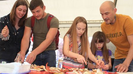Have-a-go crab dressing at the Cromer and Sheringham Crab and Lobster Festival Photo: KAREN BETHELL