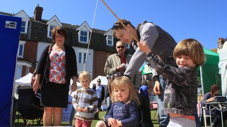 Young festival-goers try their hand at the crab lucky dip Photo: KAREN BETHELL