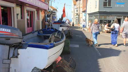 Fishing boats lining the high street at SheringhamPhoto: KAREN BETHELL