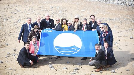 Members of the North Norfolk District Council with their blue flag on the beach at Cromer. Picture: