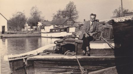 Nat Bircham on The Ella at Wroxham Bridge in 1956. It shows the wherry laden with reeds. Picture: Fa