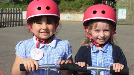 Year 2 pupils Ruby and Layla try out Sheringham Primary School's new scooters.Photo: KAREN BETHELL