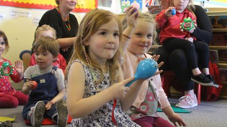 Youngsters joining in the fun at a music session run at Ladybird Pre-school Nursery by Cherry Forbes