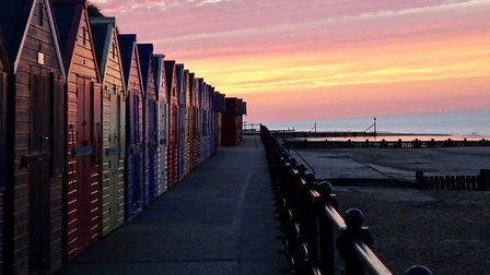 Beach huts at Mundesley at sunset. Picture: JULIE CAMERON