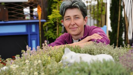 Teresa Rogers with her garden design at last year's Woodgate Nursery Garden Show Picture: MARK BULLI