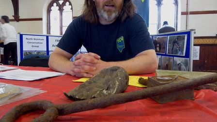 Mark Webster from The Conservation Volunteers with finds during restoration work at Honing Station.