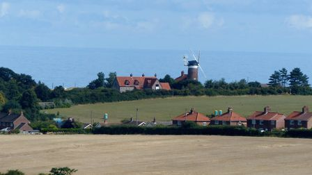 View of Weybourne Mill from the Poppy Line train. Photo: Lesley Buckley