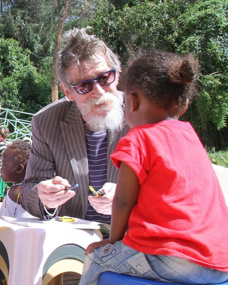 Sir John Hurt with children from the Project Harar charity.Photo: courtesy of Lady Hurt