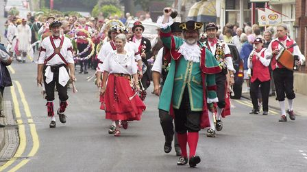 Town Crier Tony Nelson leads the dancers down Church Street at one of the first Potty Morris Festiva