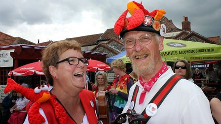 Lobster Potty Morris musicians Hilary Scotton and Graham Austin share a joke at Sheringham's annual