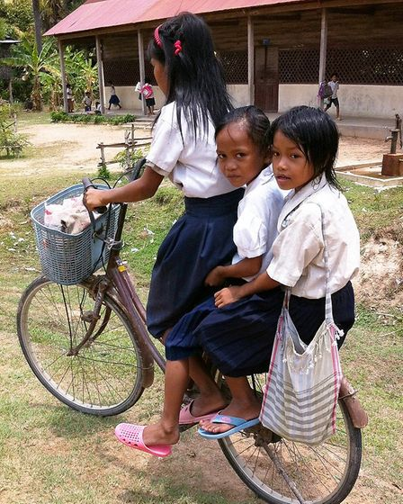 Cambodian schoolchildren on a bicycle. Picture: SUPPLIED BY KATIE MAIDMENT