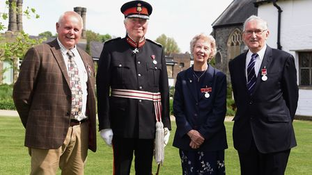 The Lord Lieutenant of Norfolk, Richard Jewson, with the recipients of the British Empire Medal, fro