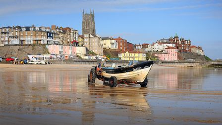 The sun shining on Cromer beach at 7.30am as a crab fisherman brings in his catch. PHOTO: ANTONY KEL