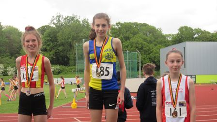 The Harriers' Hattie Reynolds collects her gold medal for the U-15 girls 3,000m. Picture: CLUB