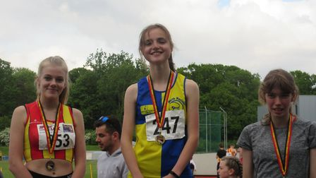 The Harriers' Abi Durand picked up gold in the U-17 girls 1,500m and 3,000m - breaking the champions