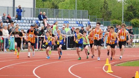 The U15 Harriers boys (blue-and-yellow halves) set off at the start of the 800m. Picture: CLUB
