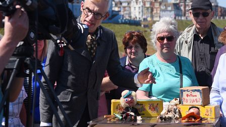 An expert looks at Maria Cox's Pelham puppets collection during filming of the Antiques Roadshow at