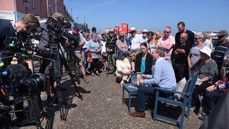 People crowd round as an expert looks at items during filming of the Antiques Roadshow at Cromer. Pi