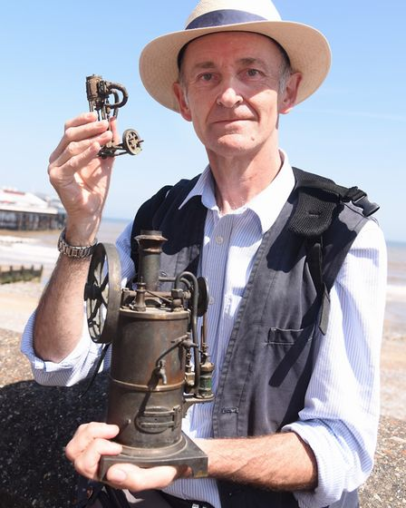 Terry Stiling with two working steam engine models, in the queue during filming of the Antiques Road