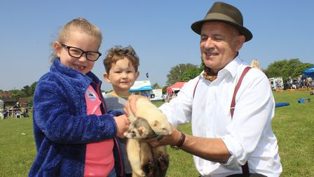Six-year-old Molly Young and her brother Toby, 3, meet ferrets Bullhead and Rag and Bone Man, brough