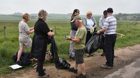 Volunteers at Salthouse beach during their litter pick, beach clean up.Byline: Sonya DuncanCopyright
