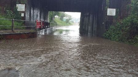Station Road in Wymondham has become flooded. Picture South Norfolk Police.