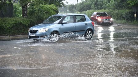 Heavy rain causes flash flooding. Roads in Spooner Row become rivers.Byline: Sonya DuncanCopyright: