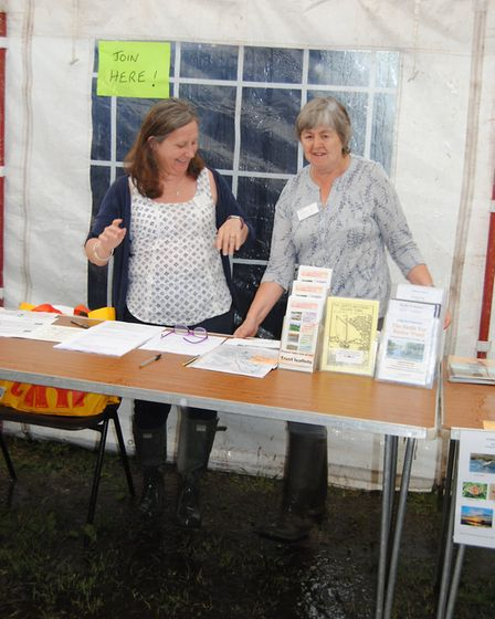 North Walsham and Dilham Canal Trust members Andrea Lamyman (left) and Mary Black splosh in their we