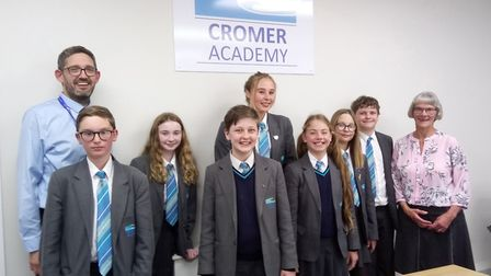 Cromer Academy headteacher Antony Little and student council with NNDC councillor Hilary Cox. Pictur