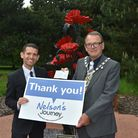 Simon Wright (left), chief executive of Nelson's Journey, receiving a cheque for £1647.36 from Cllr