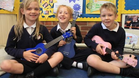 Holt Primary School pupils try their hand at playing the ukulele at an all-day event celebrating Mak