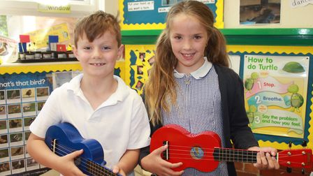 Holt Primary School pupils Alfie and Amber try their hand at playing the ukulele at an all-day event