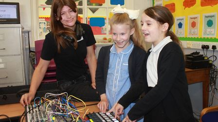 Holt Primary School pupils Ava and Ruby have a go on the DJ decks with musician Nik VoidPhoto: KAREN