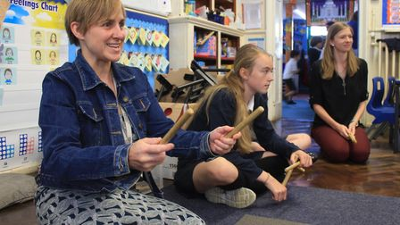Musician Alison Corfield leading a workshop at Holt Primary School as part of an all-day event celeb