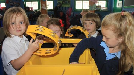 Holt Primary School reception pupils choosing instruments at an all-day event held to celebrate Make