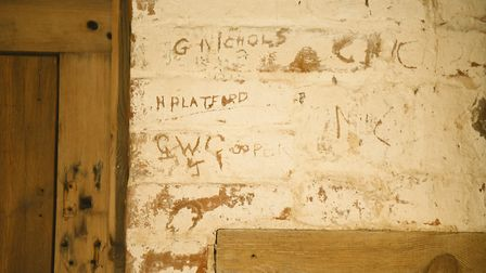 Farm workers engraved their names into the brick work inside one of the barns at Manor Farm during t