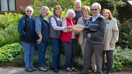 CAFOD volunteer campaigner Bernard Shaw presenting the plaque to the parish team. Picture: supplied