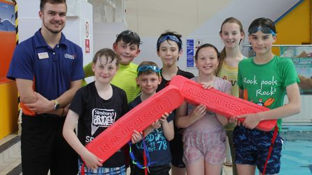 Splash swimming instructor Ryan Swift with members his rookie lifeguard group. Mr Swift and Splash o