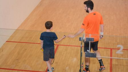 Commonwealth Games medal winner Daryl Selby coaching a younger player at Rossis in North Walsham. Pi