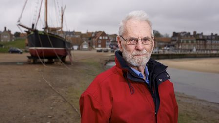 Artist and former fisherman Godfrey Sayers at Blakeney Harbour. He has written a book called Once Up