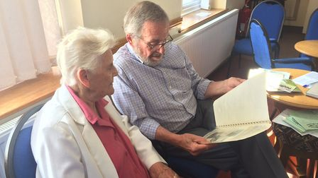 Pamela Leeder and Ron Hayton used to run the fayre. They are seen looking back at old programmes. Pi