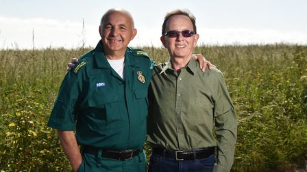 Tony Oram, from Mundesley, thanks NHS First Responder Mario Stango for helping save his life after h