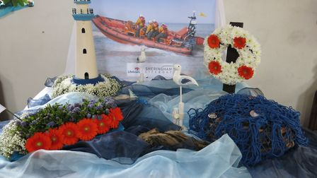 The Lifeboats by Val Kirkwood, one of the exhibits at a flower festival at Beeston Regis church. Pic