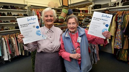 Sue Ryder charity shop volunteers, left, Thelma Yates and Eugenia Funnell, who have each worked in t
