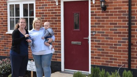 Carly Gibbs is given the keys to her new home. Picture: NNDC