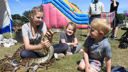 Youngsters meeting Zuess the 13 feet-long, 30kg Burmese python, brought along by Wild Touch animal r