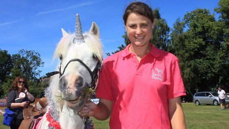 Charlotte Sheales of Scratby Donkeys with Sparkles the 'unicorn'Photo: KAREN BETHELL
